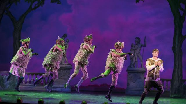 """FILE -- Andrew Durand, far right, with his sheep, in the musical """"Head Over Heels"""" at the Hudson Theater in New York, July 8, 2018. The exuberant mash-up of a 16th-century prose poem with songs of the Go-Go's, will close on Broadway on Jan. 6. (Sara Krulwich/The New York Times)"""