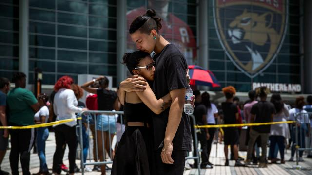 FILE - Fans mourn XXXTentacion at a public memorial at the BB&T Center in Sunrise, Fla., June 27, 2018. The 20-year-old singer and rapper, who was killed in June while facing charges that he abused a woman, left behind superfans and vocal critics. (Scott McIntyre/The New York Times)