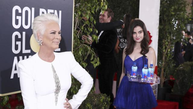 Los Angeles-based model and actress Kelleth Cuthbert went viral after photobombing celebrities on the Golden Globes red carpet. (Invision for FIJI Water)