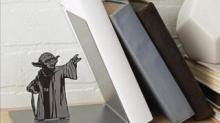 IMAGE: Cute Yoda Bookend Makes It Look Like He's Using The Force To Hold Up Your Books