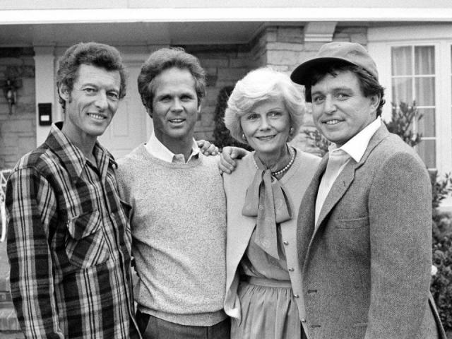 """FILE - This Dec. 10, 1982 file photo shows members of the original cast of the """"Leave It To Beaver,"""" from left,  Ken Osmond, Tony Dow, Barbara Billingsley and Jerry Mathers during the filming of their TV special, """"Still The Beaver,"""" in Los Angeles. Osmond, who played the two-faced teenage scoundrel Eddie Haskell on TV's """"Leave it to Beaver,"""" has died. Osmond's family says he died Monday, May 18, 2020, in Los Angeles. He was 76. (AP Photo/Wally Fong, File)"""