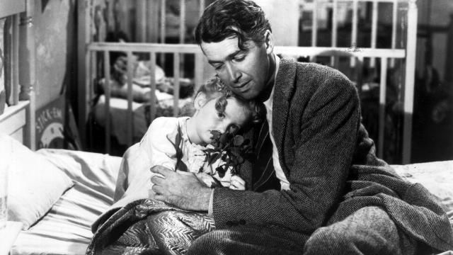 American actor James Stewart, as George Bailey, hugs actor Karolyn Grimes, who plays Zuzu his daughter, in a still from director Frank Capra's Christmas classic film, 'It's a Wonderful Life'.  (Photo by Hulton Archive/Getty Images)