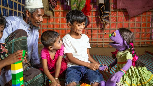 """Rohingya children raised amid political turmoil have few opportunities to see themselves represented in the media. Sesame Workshop is helping to change that. The nonprofit organization, best known for producing """"Sesame Street,"""" unveiled its first Rohingya Muppets on Thursday: 6-year-old twins Noor and Aziz. The siblings will be featured in Rohingya-language educational media along with such familiar characters as Elmo."""