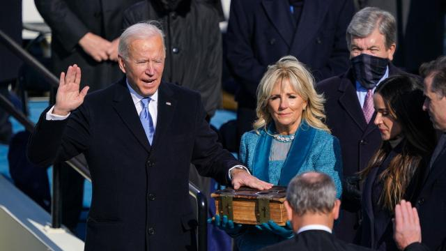 Chief Justice John Roberts swears in Joe Biden as the 46th President of the United States, as his wife Jill Biden holds a Bible at the Capitol in Washington on Wednesday, Jan. 20, 2021. At President Biden's made-for-TV swearing-in, rituals of normalcy ran into reminders that these are anything but normal times. (Chang W. Lee/The New York)