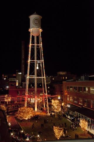 A crowd covers the American Tobacco Campus for the Lucky Strike Tower Lighting and the Triangle Christmas Tree Challenge Friday Evening in Durham. The Lighting ceremony included acrobatics as well as live music.