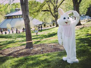 The Easter Bunny waves to kids before the official start of the hunt.