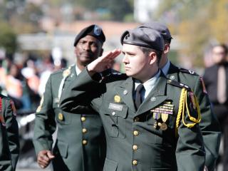 A man salutes to the flag in the Veterans Day Parade Saturday morning in Fayetteville, NC (photo by Wes Hight).