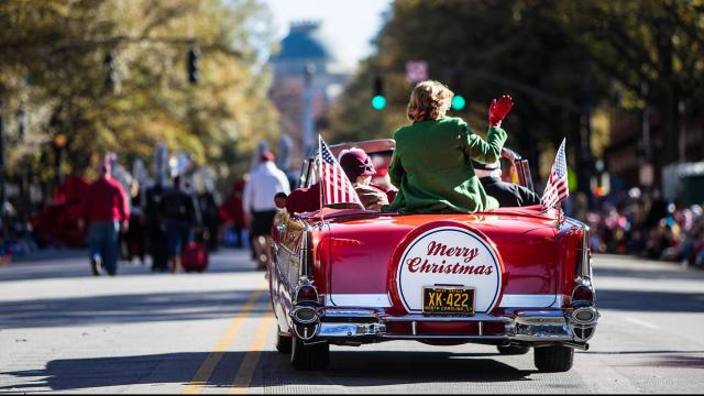 Mayor Nancy McFarlane makes her way down Hillsborough Street, toward the State Capitol, along the 2015 Raleigh Christmas Parade, waving to the crowds on Nov. 21, 2015. (Photos by: JOHN WEST)