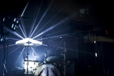 Black Clouds drummer Jimmy Rhodes is washed in light during the band's set at Lincoln Theater for Hopscotch 2015. (Jake Seaton / WRAL.com)