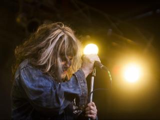 X vocalist Exene Cervenka performs on the City Plaza stage during the final night of Hopscotch 2015. (Jake Seaton / WRAL.com)