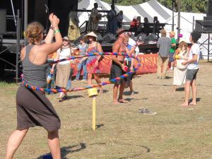 Festival goers learning to juggle, and hula hooping during performances.