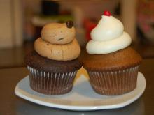 A dark chocolate and espresso buttercream cupcake and the holiday gingerbread one.