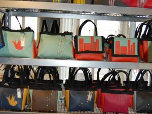 Bags in retro colors adorn the shelves at Stitch + Holly Aiken in Raleigh