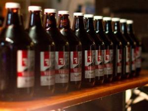 A row of Fullsteam growlers. (Photo by Richard Mitchell)