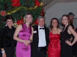 The Out & About team: Account Executive Liz McKee, Calendar Editor Sarah Adams, Creative services director John Conway, Marketing Coordinator Lisa Jeffries and Interim Coordinator Kathy Hanrahan pose at the 2011 WRAL Holiday Party.