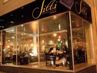 Sitti's golden glow is welcoming on the corner of Hargett and Wilmington in downtown Raleigh. (Photo courtesy Empire Eats)
