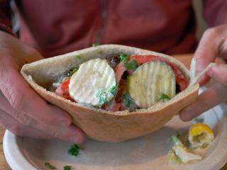 Falafel, pickles and other vegetables stuffed into a freshly baked pita pocket at Neomonde in Morrisville.