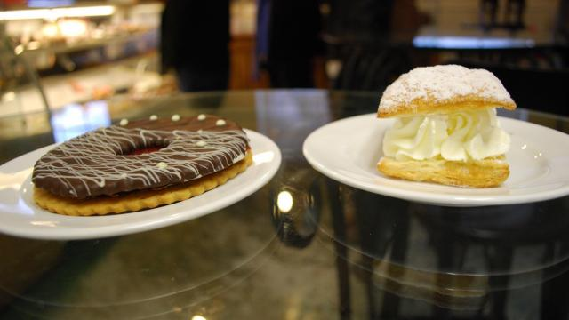 A chocolate linzer cookie and cream puff at Guglhupf bakery in Durham.