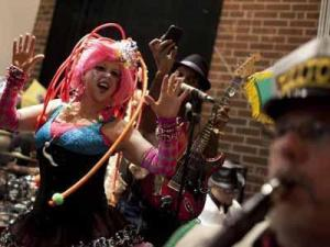 The Bulltown Strutters kept the crowd pumped at a Masquerade Ball at Fullsteam Brewery during the Mardi Gras Parade in Durham, February 21, 2012.