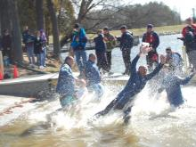 People took the plunge into Lake Raleigh on N.C. State University's Centennial Campus to help raise money for Special Olympics North Carolina.