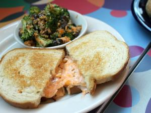 A grilled pimento cheese sandwich from Nofo at the Pig. It is accompanied by some broccoli salad. (Photo by Sarah Adams)
