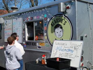 Klausie's serves pizza by the slice at the Food Truck Rodeo at Durham's Central Park on Sunday, March 11, 2012.