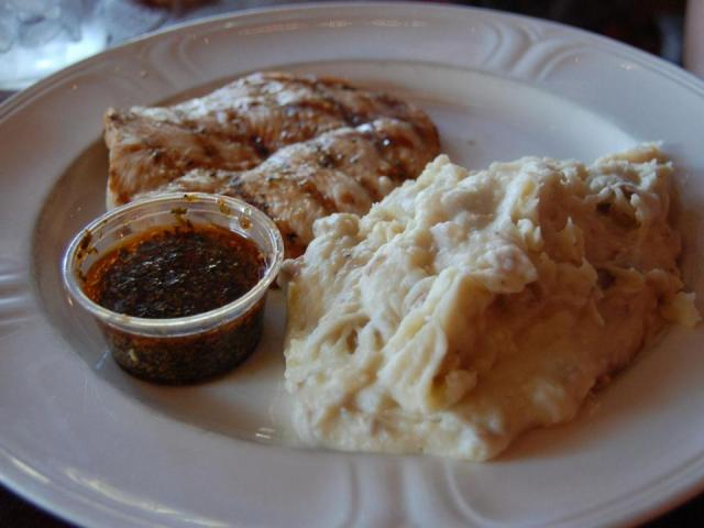The char-grilled chicken and mashed potatoes at Oakwood Cafe in Raleigh.<br/>Photographer: Kathy Hanrahan
