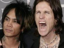 Stevie D., left, and Josh Todd, of Buckcherry, arrive for the 49th Annual Grammy Awards on Sunday, Feb. 11, 2007, in Los Angeles.  (AP Photo/Matt Sayles)