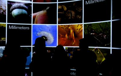 Viewers watch a movie about length scales in the SECU Daily Planet during the opening of the Nature Research Center at the North Carolina Museum of Natural Sciences on April 20, 2012.