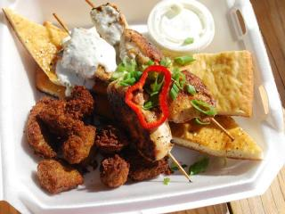 Chicken souvlaki skewers with tzatziki sauce and falafel tots from Mama Dukes food truck in Durham.