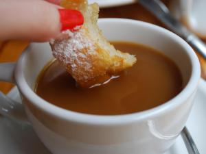 Fresh beignets pair perfectly with rich coffee at Rue Cler in Durham.