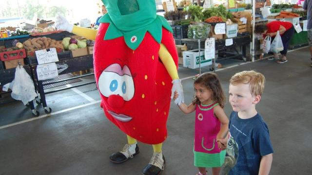 Suzy the Strawberry posed for photos with the crowd.