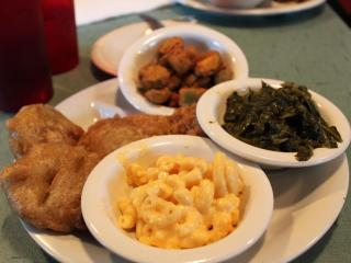Clockwise from top: Fried okra, collard greens, mac and cheese, fried green tomatoes.