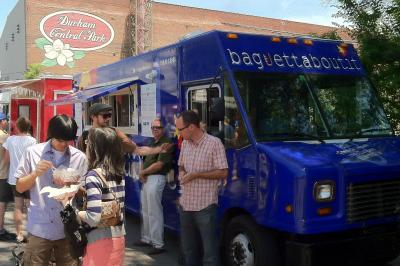 "Food truck fans enjoy sandwiches from ""Baguettaboutit."" (Photo by Tony Rice)"