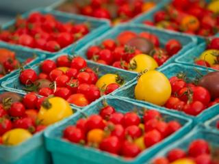 Fresh cherry tomatoes are for sale at Edible Earthscapes during the Midtown Farmers Market at North Hills in Raleigh on July 14, 2012.
