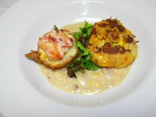 Course 1: Corn & Lobster Crab Cake with Smoky Corn Chowder, Corn & Bacon Beignet & Citrus-Ginger Herb Salad. (Photo by Judy Royal.)