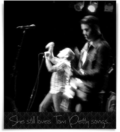 Taken at Cat's Cradle.  Comment: She still loves Tom Petty songs...