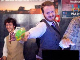 Get your water gun ready, it is time for the Triangle Wars. This gamer takes a shot during the annual Assassins Ball held last year at The Union in Raleigh. (Image from Raleigh Wars' Facebook page)