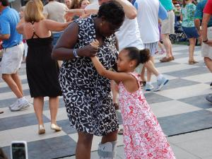 Crowds dance to the sounds of Liquid Pleasure at the North Hills Beach Music Series on Aug. 2, 2012.
