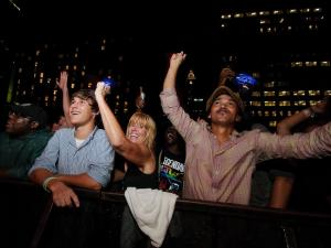 Fans cheer as The Roots perform on the city plaza stage during the Hopscotch Music Festival in downtown Raleigh on Saturday September 8, 2012.