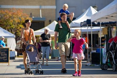 Families enjoy the weather during the Midtown Farmers Market at North Hills in Raleigh on September 15, 2012.