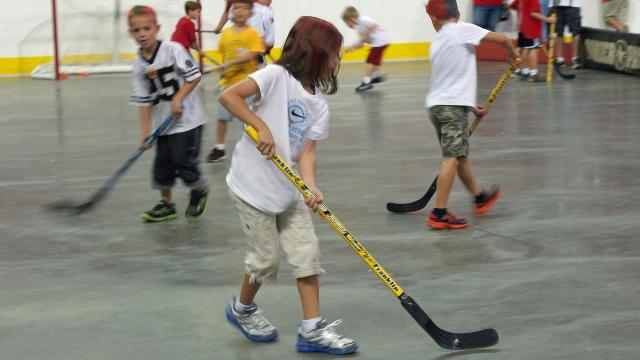 Parents and children played floor hockey inside PNC Arena at the 2012 Caniac Carnival.