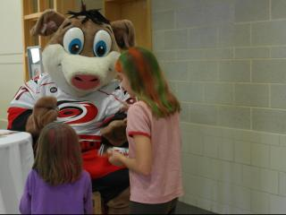Stormy signed autographs for fans at the 2012 Caniac Carnival.