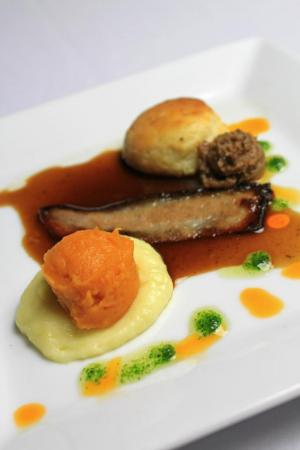Course 1: Pepsi-Braised Jowl Bacon, Black Pepper Biscuit, Pepsi-Black Currant Red Eye Gravy, Candied Jowl Jelly, Potato Egg. (Photo from Competition Dining Facebook.)