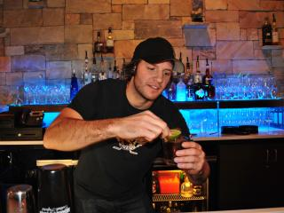 Former Carolina Hurricanes player Bates Battaglia serves up drinks at Zinda's first Celebrity Bartending event.