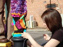 "The people who enjoy knitting and crocheting in Cary are a ""close-knit"" bunch. They helped line Chatham Street with these colorful patches on Saturday, Jan. 12, 2013. The yarn will remain until the end of the April."