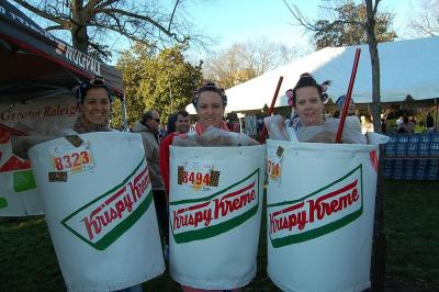 Runners participate in the costume contest at the 2013 Krispy Kreme Challenge.