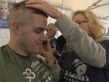 Hundreds shave for cancer research