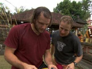 "Bates and Anthony Battaglia must assemble an elaborate religious offering known as a ""Gebogan"" then take it to the Pura Desa Puseh Temple for a blessing in order to receive the next clue (Photo from CBS.com)."