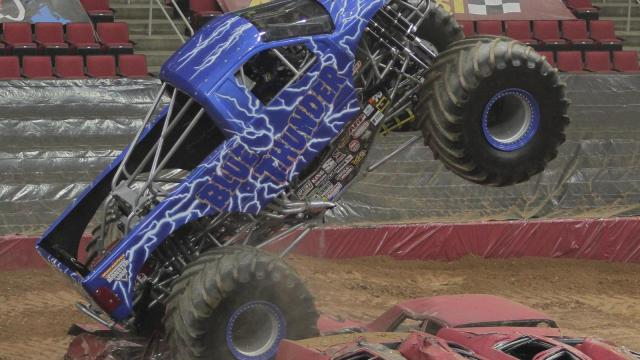The Blue Thunder crushes cars during the Advance Auto Parts Monster Jam at the PNC Arena in Raleigh, NC Friday night (photo by Wes Hight).